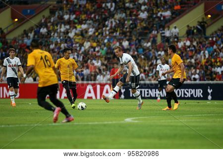 May 27, 2015- Shah Alam, Malaysia: Tottenham Hotspur's striker Harry Kane (18) kicks the ball in the friendly match against Malaysia (orange jersey). Tottenham Hotspur is on a Asia-Australia tour.