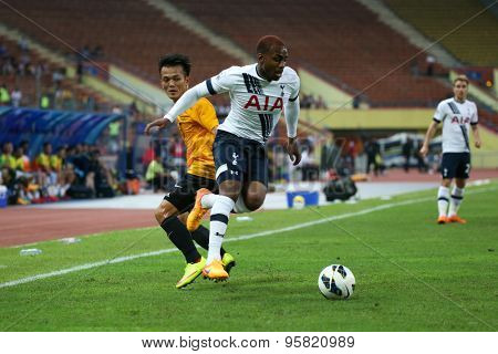 May 27, 2015- Shah Alam, Malaysia: Tottenham Hotspur's Danny Rose (white) fights for the ball with Malaysia's Joseph Kalang (orange) in a friendly match. Tottenham Hotspur is on a Asia-Australia tour.