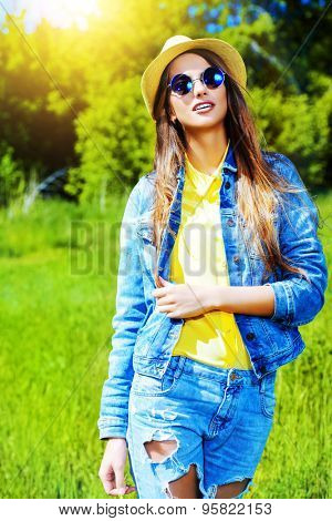 Beautiful smiling girl wearing casual summer clothes enjoys sunny day. Beauty, fashion shot.