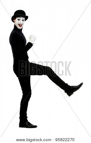 Full length portrait of a male mime artist performing different emotions. Isolated over white.