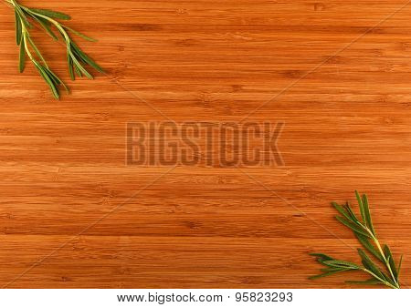 Wooden Bamboo Cutting Board With Rosemary Leaves