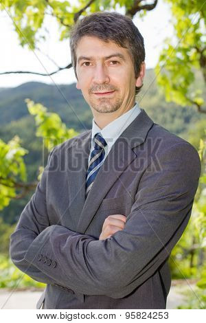 portrait of a young happy businessman, outdoors