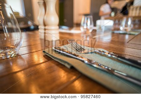 Knife and fork set on a wooden vintage table. Selective Focus