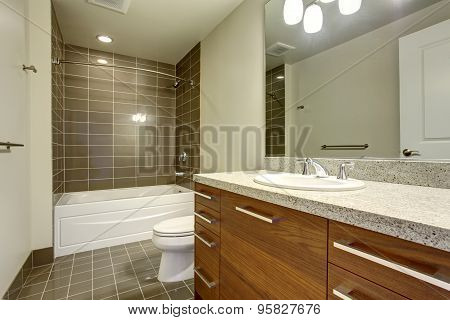 Modernized Bathroom With Tile Floor And Nice Bathtub.