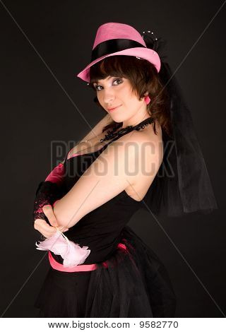 Girl Posing With Pink Hat And Pink Flowers