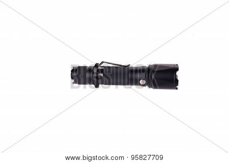 black LED flashlight isolated on white background