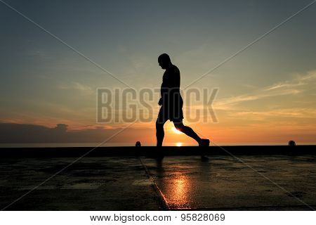 Silhouette Image Of Man Walking On The Helideck In The Evening For Excercising.
