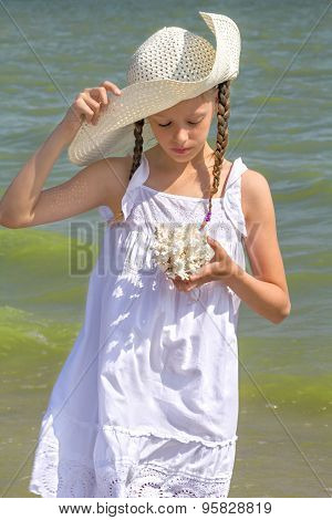 Girl Examines The Coral On The Beach, Close Up