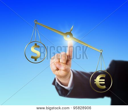 Euro Sign Outweighing The Dollar On A Balance