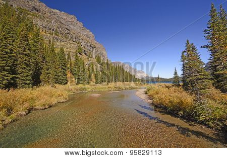 Quiet Stream Leading To A Mountain Lake