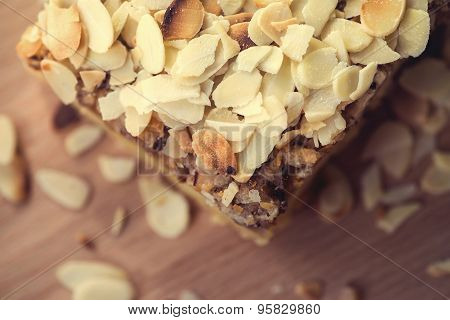 Pieces of apple pie decorated on wooden table
