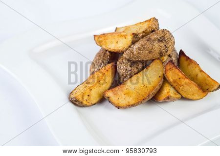 Fried potato wedges on plate. white background