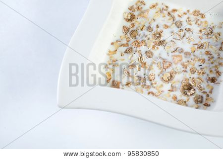 Plate of oats porridge isolated on a white background. Healthy breakfast
