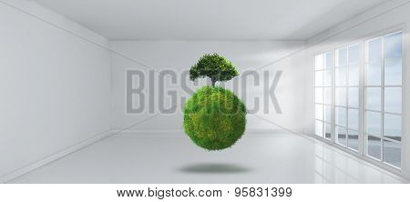 3D Render of a grassy globe with tree in an empty room with windows