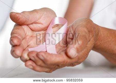 Elder Woman Hands Holding Pink Breast Cancer Awareness Ribbon