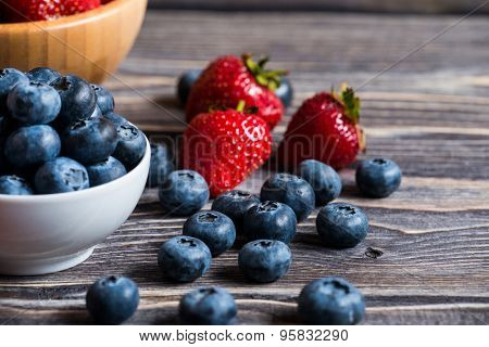 Berry over Wood. Strawberries and  Blueberry