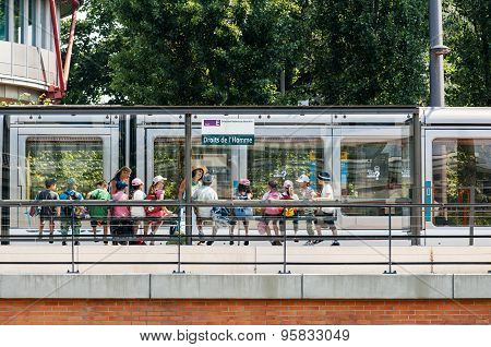 Group Of Kids Waiting Tram At Human Rights Station