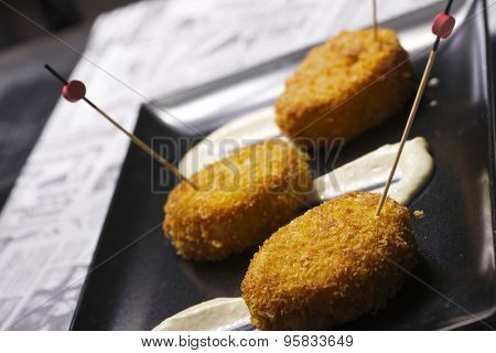 Chicken croquettes with cucumber sauce.