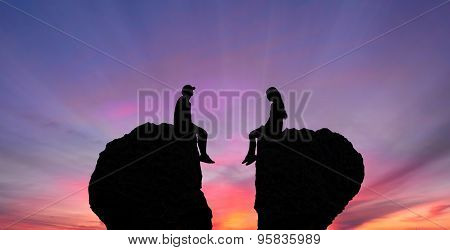 Young Couple In Quarrel Sitting On Rocks