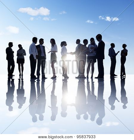 Group Of Business People Standing Outdoors In A Rural Scene