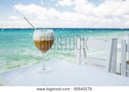 Cocktail on a table against the sea