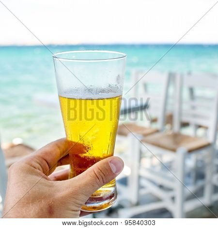 glass of beer in his hand