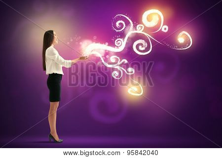 laughing pretty woman holding in her palms beautiful glow over purple background