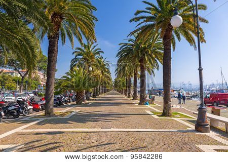 LA SPEZIA, ITALY - APRIL 13, 2015: People on the promenade at Ligurian Sea in La Spezia, Italy. La Spezia is a city in the Liguria region located between Genoa and Pisa.