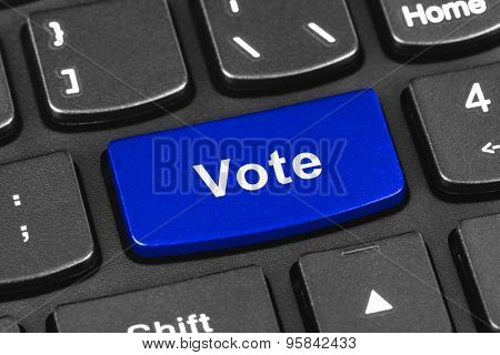 Computer notebook keyboard with Vote key - technology background