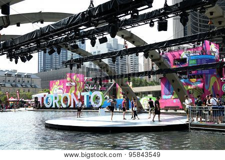 TORONTO CANADA JULY 2015: Dancer rehearsing during Toronto panamerican game at the principal site at Nathan Phillips square in Toronto, Canada with town hall in background,