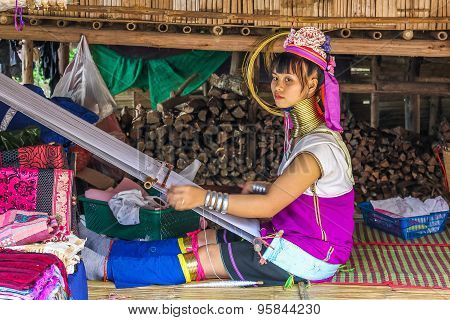 Kayan girl with loom
