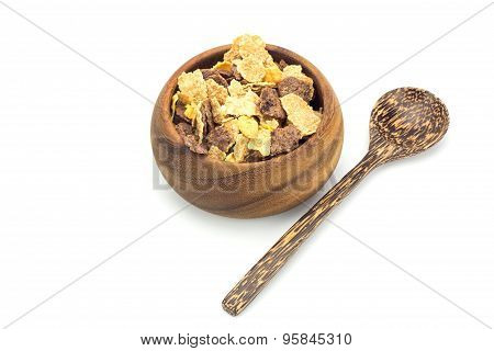 Cereal In Wooden Blow And Wooden Spoon On White Background
