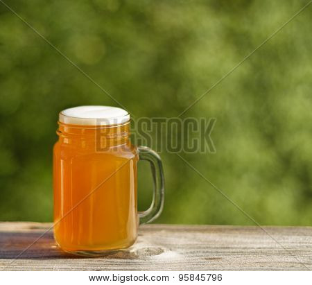 Full Pint Of Golden Beer Ready To Drink Outdoors