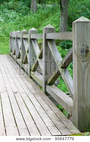 Railing And Fence Of Wooden Bridge In The Park