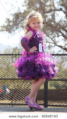 Little Blond Angel In Purple Dress At Beauty Pageant