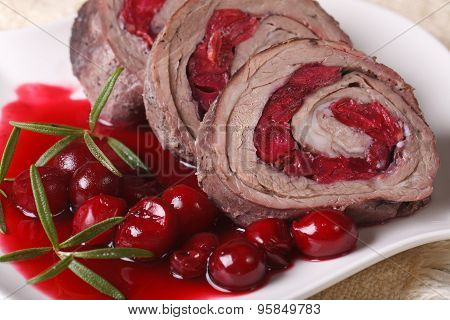 Meat Roll With Cherries Closeup On A Plate. Horizontal