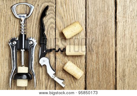 Still life with two cork-screws and wine corks with space for text