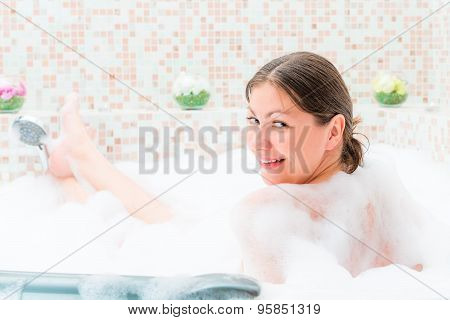 Single Girl Sitting In The Jacuzzi With Foam