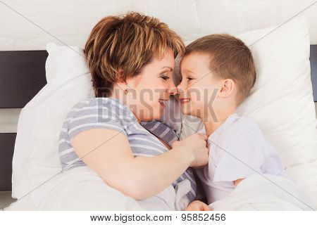 Happy woman and her son enjoying each other