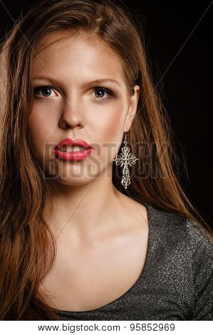 Teen Girl With An Evening Makeup Looking At Camera