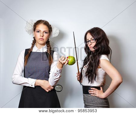 Teacher With Pointer. Schoolgirl With Magnifying Glass And Apple.