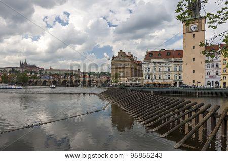 Charles Bridge is famous historic bridge that crosses Vltava river.