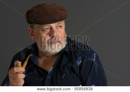 Senior man with tobacco-pipe