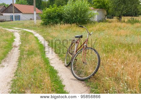 Old bicycle waiting for the master on the roadside