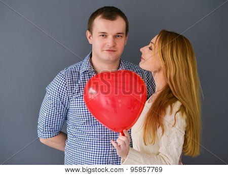 Beautiful Couple In Love With Red Balloon Heart Shape For Valentine's Day, On Gray Background