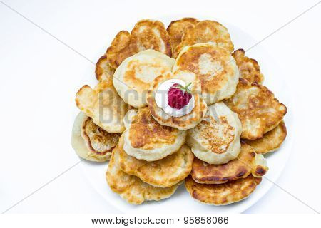 Heaps of pancakes with raspberry, top view