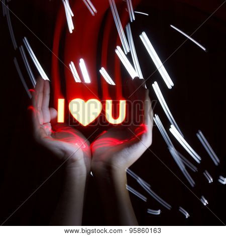 Light Painting Photography. Freezelight Photo. Hands Holding A Glowing Massage With Freezelight Effe