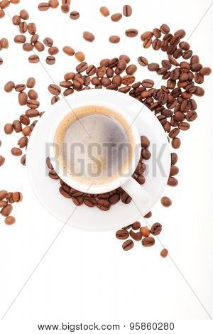 coffee in a white cup with scattered grains. Isolated on white background