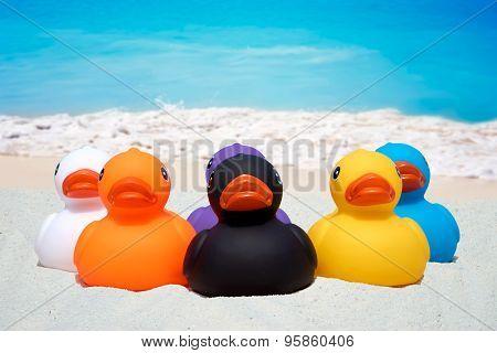 Six Rubber Ducks On The Sand Beach