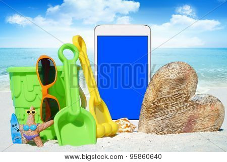 White Smartphone And Beach Toys